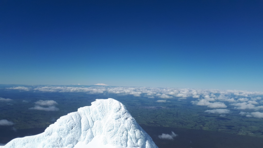 Looking on in Ruapehu's direction (the last mound of white in the photo) from the summit